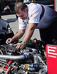 Monterey California, May 4, 2014, Laguna Seca Monterey Grand Prix, racing engineer works om engine.