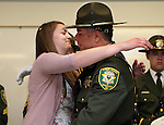 Tessa Richards congratulates her father Sgt. Bill Richards during a promotion ceremony at the Carson City Sheriff's Office in Carson City, Nev., on Wednesday, April 24, 2013. .Photo by Cathleen Allison