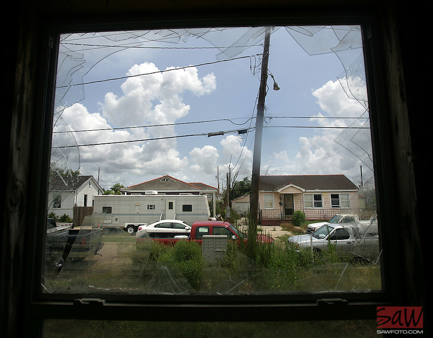 New Orleans, La.- Gentilly neighborhoods slowly returning. A shattered window frames homes in the Gentilly neighborhoods August 17,2007. Most of the homes are abandoned two years later, the neighborhood was almost completed flooded during Hurricane Katrina.