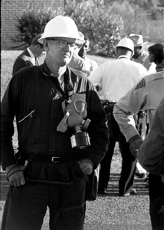 Crenshaw County Deputy Sheriff keeping media from overhearing negotiations between Luverne Police and James Kolb who is leading a protest march toward downtown Luverne, Ala. This and over 10,000 other images are part of the Jim Peppler Collection at The Alabama Department of Archives and History:  http://digital.archives.alabama.gov/cdm4/peppler.php