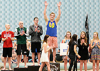Madison West's Lain Weaver receives his medal for winning the 100-yard butterfly during the Wisconsin Division 1 state championship swimming and diving meet at the UW Natatorium on Saturday, 2/17/18 in Madison