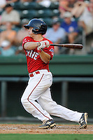 Catcher Jake Romanski (12) of the Greenville Drive bats in a game against the Asheville Tourists on Tuesday, July 1, 2014, at Fluor Field at the West End in Greenville, South Carolina. Asheville won, 5-2. (Tom Priddy/Four Seam Images)
