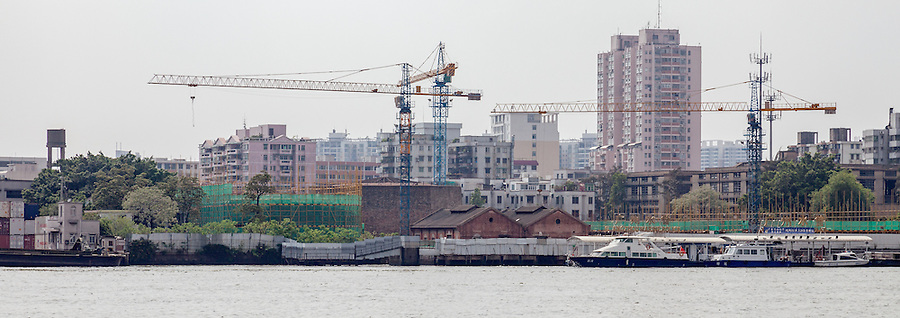 Asiatic Petroleum Storage Tanks Under Restoration From Opposite River Bank.