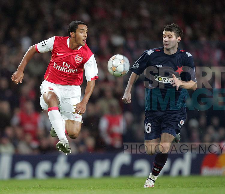 Arsenal's Theo Walcott tussles with Slavia Prague's Daniel Pudil