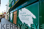Christy's shop have put signs on their boarded up windows in Killarney on Monday