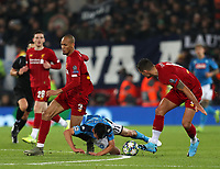 27th November 2019; Anfield, Liverpool, Merseyside, England; UEFA Champions League Football, Liverpool versus SSC Napoli ; Fabinho of Liverpool collides with Hirving Lozano of SSC Napoli resulting in an injury which required his substitution - Editorial Use