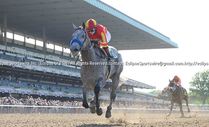 Midnight Lucky (no. 5), ridden by Rosie Napravnik and trained by Bob Baffert, wins the  83rd running of the grade 1 Acorn Stakes for three year old fillies on May 27, 2013 at Belmont Park in Elmont, New York.  (Bob Mayberger/Eclipse Sportswire)