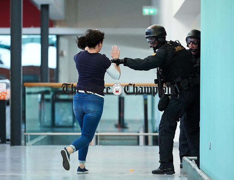 A hostage who was being held by an attacker is released to safety after he was shot by heavily armed Garda personnel during a bilateral training exercise between An Garda Siochana and the Defence Forces hosted at Shannon Airport. Photograph by John Kelly.