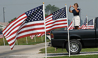 A stands in the bed of her truck to photograph  a field of 3,000 flags installed in a wheat field in Maria Stein, Ohio, Monday, September 11, 2006. The display was erected to honor military, police, fire fighters, and emergency workers on the anniversary of the attacks on the World Trade Center and Pentagon in 2001.<br />