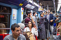 LISBON, PORTUGAL - March 11:  A Passenger wearing  a protective mask its seen on the subway on March 11, 2020 in Lisbon, Portugal. <br /> The International Air Transport Association (IATA) warned earlier on Thursday that the virus could rob passenger airlines of up to $113 billion in revenue this year as fears of a pandemic that could plunge the global economy into recession grow.<br /> Airlines across the globe are rushing to cut flights and costs, and warning of a hit to earnings.<br /> Portugal, whose economy depends heavily on tourism, has so far reported 59 positive cases of the Coronavirus, far fewer than the more than 2200 cases in neighboring Spain.<br /> <br /> (Photo by Luis Boza/VIEWpress vía Getty Images)