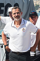 King Felipe VI of Spainposes with Aifos ship's crew