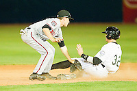 Ryan Garvey (32) of the Grand Junction Rockies is tagged out by Zach Vincej (4) of the Billings Mustangs as he tries to steal second base at Suplizio Field on July 24, 2012 in Grand Junction, Colorado.  The Rockies defeated the Mustangs 4-3.  (Brian Westerholt/Four Seam Images)