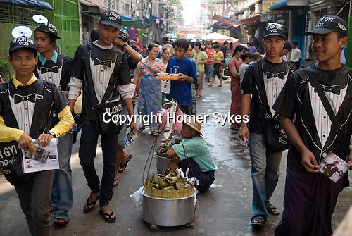 Promotional boys teenagers promoting the popular singer U Jon Gyi. He has released a new CD. Rangoon Yangon Burma Myanmar 2011.