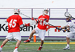 University at Albany Men's Lacrosse defeats Cornell 11-9 on Mar 4 at Casey Stadium.  John Piatelli (#41) shoots.