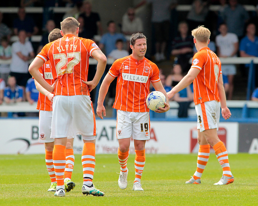 Blackpool&rsquo;s David Norris trudges back to the centre circle with the ball after Peterborough United score<br /> <br /> Photographer David Shipman/CameraSport<br /> <br /> Football - The Football League Sky Bet League One - Peterborough United v Blackpool  - Sunday 8th May 2016 - ABAX Stadium - London Road   <br /> <br /> &copy; CameraSport - 43 Linden Ave. Countesthorpe. Leicester. England. LE8 5PG - Tel: +44 (0) 116 277 4147 - admin@camerasport.com - www.camerasport.com