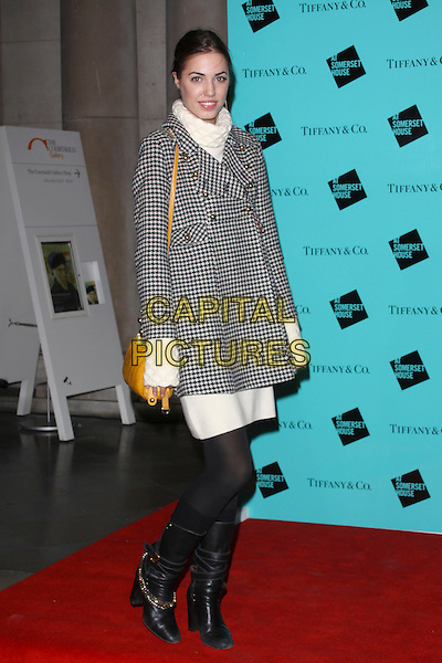 AMBER LE BON.Tiffany & Co. presents Skate at Somerset House, VIP Opening of the 10th Annual Somerset House Ice Rink, London, England..November 16th, 2009.full length black boots chloe gold chains cream white polo neck jumper sweater dress yellow tan bag black checked coat gingham check tights houndstooth gold brass buttons dogtooth lebon.CAP/AH.©Adam Houghton/Capital Pictures.