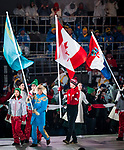 PyeongChang 18/3/2018 - Mark Arendz carries Canada's flag at the closing ceremonies during the 2018 Winter Paralympic Games in Pyeongchang, Korea. Photo: Dave Holland/Canadian Paralympic Committee