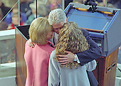 United States President William Jefferson Clinton kisses his wife, Hillary and embraces his daughter Chelsea after taking the oath for his second term in office at the U.S. Capitol on Monday, January 20, 1997.  <br /> Credit: Ron Sachs / CNP
