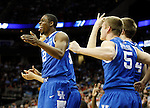 Players on the bench celebrate a 3 made by DeAndre Liggins in the second half of UK's Sweet 16 NCAA tournament win, 62-60 against 1 seed Ohio State at the Prudential Center in Newark, New Jersey on Friday, March 25, 2011.  Photo by Britney McIntosh | Staff