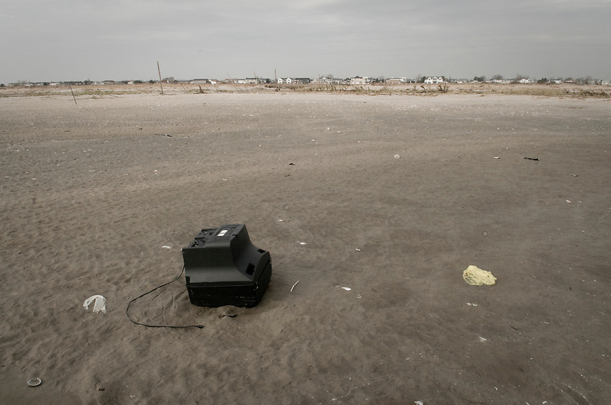 Furniture and belongings left by the receding  water  can be found some 500 meters from the devastated d by Hurricane Sandy village  Breezy Point.