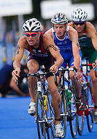07 AUG 2011 - LONDON, GBR - Matt Chrabot (USA) leads Jonathan Brownlee (GBR) and Hendrik de Villiers (RSA) onto the start of another lap of the bike during the men's round of triathlon's ITU World Championship Series (PHOTO (C) NIGEL FARROW)