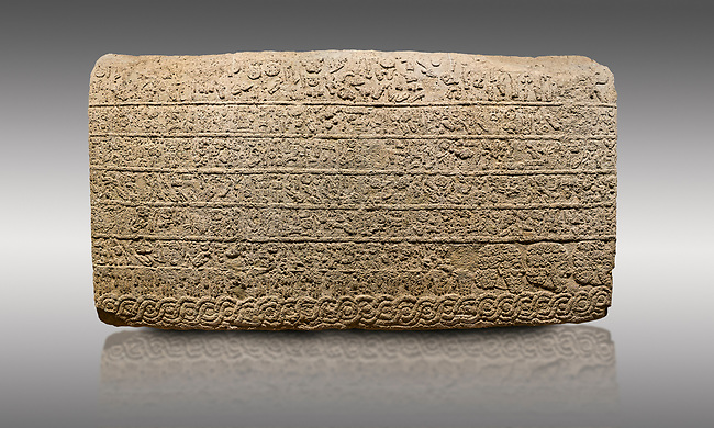 Picture & image of Hittite sculpted Orthostats panel from the  Long Wall.  Limestone, Kargarmis, Gaziantep, 900 - 700 BC,  Hieroglyph. Anatolian Civilisations Museum, Ankara, Turkey.<br /> <br /> In the epigraph with hieroglyph, he narrates that the gods were provoked against him, the account of the cities conquered and the spoils of war; that he allocated a share for the gods, and that he instigated the mighty king Tarhunza and the other gods. In the other lines, he demands that people should present offerings to statues but should evil-intentioned people be among them, such person individuals be punished by the gods.  <br /> <br /> On a gray background.