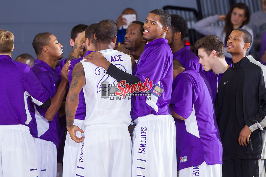 Allan Chaney (13) of the High Point Panthers huddles with his teammates during a timeout in the game against the Wofford Terriers at Millis Athletic Center on November 24, 2013 in High Point, North Carolina.  The Panthers defeated the Terriers 66-56.   (Brian Westerholt/Sports On Film)
