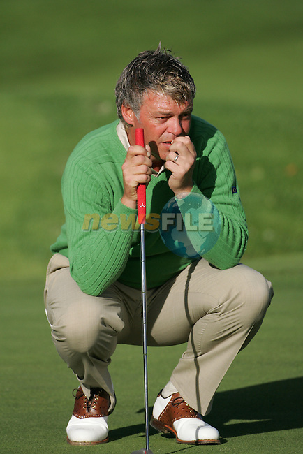 Straffin Co Kildare Ireland. K Club Ruder Cup...European Ryder cup team members Darren Clarke lining up his putt on the forth  green during the opening fourball session of the first day of the 2006 Ryder Cup, at the K Club in Straffan, Co Kildare, in the Republic of Ireland, 22 September 2006..Photo: Fran Caffrey/ Newsfile.<br />