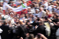 Vatican City, October 13, 2019. Pope Francis is driven through the crowd as faithful wave Ecuadorian flags, in St. Peter's Square at the Vatican. Francis presided over Mass on Sunday in a packed St. Peter's Square to declare Cardinal John Henry Newman and four women saints. (Antonello Nusca/BuenavistaPhoto)