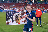 FRISCO, TX - MARCH 11: Rose Lavelle #16 of the United States shows off a fan's artwork during a game between Japan and USWNT at Toyota Stadium on March 11, 2020 in Frisco, Texas.