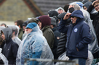 Peterborough United fans brave the wintry weather as they stand on the uncovered terrace during Gillingham vs Peterborough United, Sky Bet EFL League 1 Football at the MEMS Priestfield Stadium on 10th February 2018