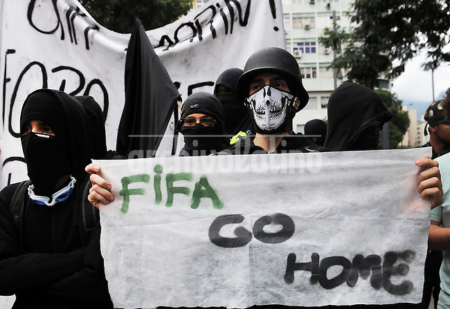 Demonstrators participate in a protest in Rio de Janeiro, Brazil, 30 June, 2013. Around 4,000 people gathered to denounce corruption, poor public services despite a heavy tax burden, and also the billions of dollars spent to host the World Cup and the 2016 Olympics in Rio - money they say should be going toward better hospitals, schools, transportation projects and schools. (Austral Foto/Renzo Gostoli)