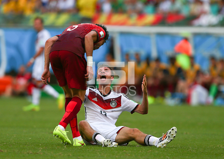 Pepe of Portgual headbutts Thomas Muller of Germany and is shown a red card