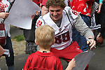 Travis Long signs autographs prior to the culmination of the first spring practice under new head coach Mike Leach at the Crimson and Gray Game at Joe Albi stadium in Spokane, Washington, on Saturday, April 21, 2012.