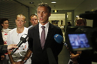 (Oslo July 22, 2011) Prime Minister Jens Stoltenberg flanked by dr. P&aring;l Aksel N&aelig;ss speaks at Ullev&aring;l hopspital. A  large vehicle bomb was detonated near the offices of Norwegian Prime Minister Jens Stoltenberg on 22 July 2011. Although Stoltenberg was reportedly unharmed the blast resulted in several injuries and deaths. <br /> Another terrorist attack took place shortly afterwards, where a man killed over 80 children and youths attending a political camp at Ut&oslash;ya island. <br /> Anders Behring Breivik was arrested on the island and has admitted to carrying out both attacks.<br /> (photo:Fredrik Naumann/Felix Features)