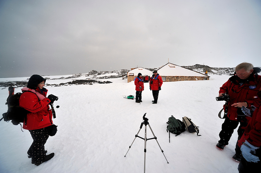 Home Inspection - Waiting our turn to inspect Mawson's Hut.  Only 7 minutes per group of 4, including your guide are allowed in at one time.  Bring your own light!