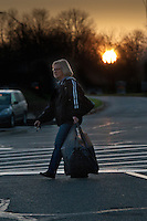 The sun rises as shoppers leave a Kohls store Westerville, Ohio, on Black Friday, the first official day of the Christmas shopping season.