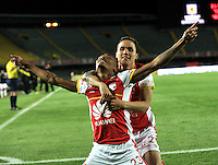 BOGOTA - COLOMBIA - 03-10-2015: Luis Quiñonez (Izq.) y Luis Seijas (Der.), jugadores de Independiente Santa Fe celebran un gol anotado al Atletico Junior, durante partido por la fecha 15 entre Independiente Santa Fe y Atletico Junior, de la Liga Aguila II-2015, en el estadio Nemesio Camacho El Campin de la ciudad de Bogota. / Luis Quiñonez (L) and Luis Seijas (R)  players of Independiente Santa Fe, celebrate a scored goal to Atletico Junior, during a match of the 15 date between Independiente Santa Fe and Atletico Junior, for the Liga Aguila II -2015 at the Nemesio Camacho El Campin Stadium in Bogota city, Photo: VizzorImage / Luis Ramirez / Staff.