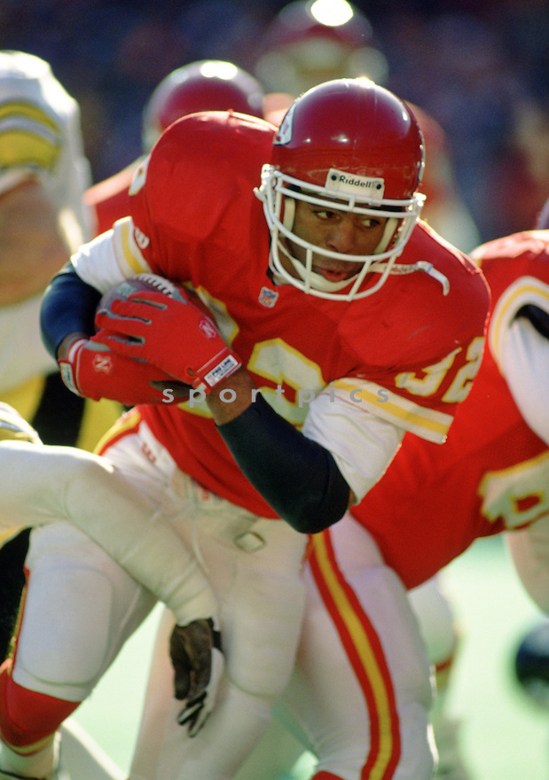 Kansas City Chiefs Marcus Allen (32) during a game against from his 1994 season with the Kansas City Chiefs. Marcus Allen played for 16 years with 2 different teams, was a 6-time Pro Bowler and was inducted to the Pro Football Hall of Fame in 2003.
