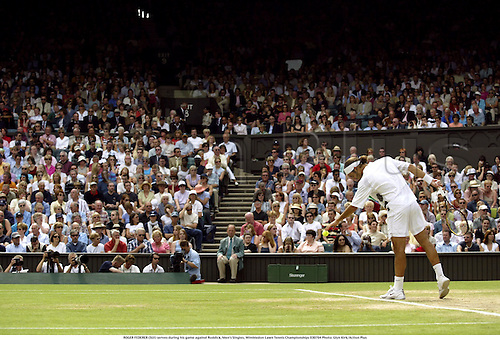 ROGER FEDERER (SUI) serves during his game against Roddick, Men's Singles, Wimbledon Lawn Tennis Championships 030704 Photo: Glyn Kirk/Action Plus...2003 player players man mens men's.ball sport sports.serve service serving...............