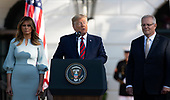 United States President Donald J. Trump, center, makes remarks as he and first lady Melania Trump, left, participate in the arrival ceremony in honor of Prime Minister Scott Morrison of Australia, right,  on the South Lawn of the White House in Washington, DC on Friday, September 20, 2019.<br /> Credit: Ron Sachs / CNP