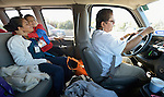 Grace Hernandez (right) drives refugees from El Salvador to the airport in San Antonio, Texas, on December 2, 2015. Behind her is Silvia Penado and her son Jacobo, who excitedly hugs his mother. They fled their country to escape gang-related violence. After requesting political asylum in the United States, they were held for several days by immigration officials and then released, although Penado was required to wear an ankle monitor. They stayed briefly in a shelter run by the Refugee and Immigrant Center for Education and Legal Services (RAICES) and supported by a coalition of San Antonio churches, then flew to another location in the U.S. while they await final decisions on their asylum petitions. Hernandez is a volunteer with RAICES.