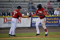 Potomac Nationals manager Tripp Keister (7) congratulates Gilbert Lara (6) after hitting a home run during a Carolina League game against the Myrtle Beach Pelicans on August 14, 2019 at Northwest Federal Field at Pfitzner Stadium in Woodbridge, Virginia.  Potomac defeated Myrtle Beach 7-0.  (Mike Janes/Four Seam Images)