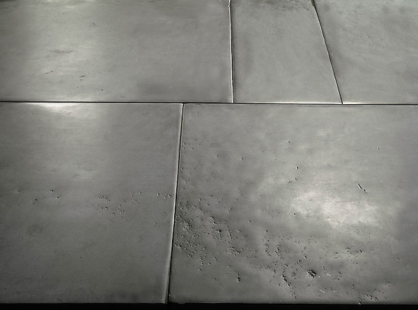 Solid Natural Limestone Tiles of a very consistent composition, with straight cut, slightly pillowed edge, naturally undulated, high honed surface. Shown in Gray. <br />