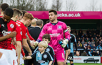 Captain Goalkeeper Matt Ingram of Wycombe Wanderers leads the handshakes during the Sky Bet League 2 match between Wycombe Wanderers and Crawley Town at Adams Park, High Wycombe, England on 28 December 2015. Photo by Andy Rowland / PRiME Media Images