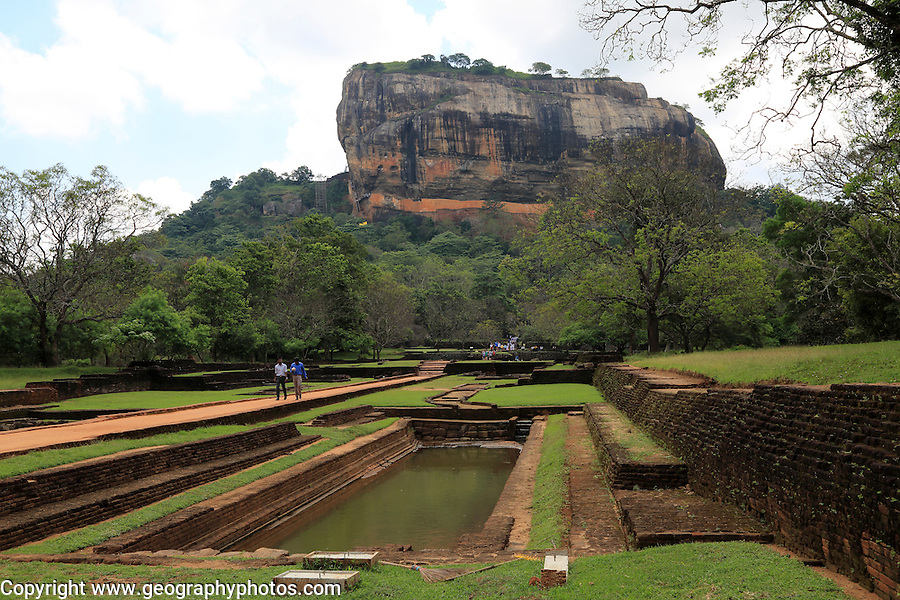 Tourists walking in the palace water gardens, Sigiriya Rock palace, Central Province, Sri Lanka, Asia