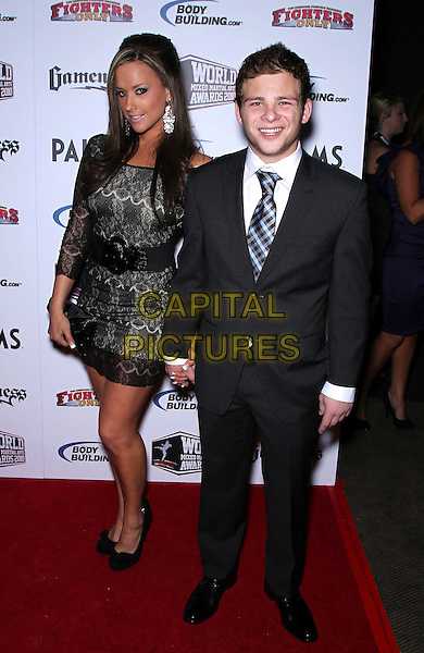 KRISTINA SAGE & JONATHAN LIPNICKI .Third Annual Fighters Only Mixed Martial Arts Awards at the Palms Resort Hotel and Casino, Las Vegas, Nevada, USA, .1st December 2010..full length black dress lace suit tie holding hands .CAP/ADM/MJT.© MJT/AdMedia/Capital Pictures.