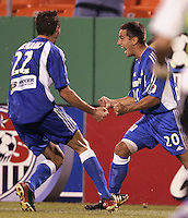 Igor Simutenkov celebrates after scoring a golden goal in overtime to help Kansas City  win the US Open Cup over Chicago 1-0, at Arrowhead Stadium, in Kansas City, MO, Wednesday, Sept., 22, 2004.