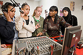 Youth worker Carol Archibald with an after-school group in the radio studio at the New Avenues Youth Club, Queen's Park.