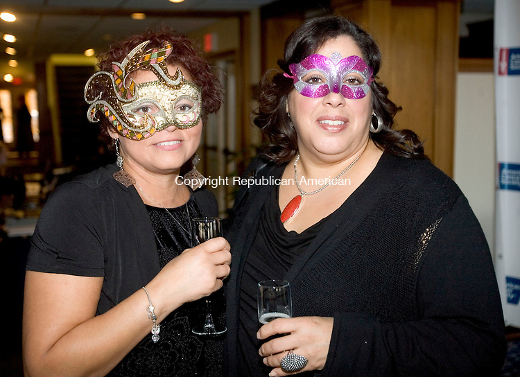 GOSHEN CT. 26 October 2013-102613SV19-From left, Doris Baker of Bantam and Leah Rodriguez of New Milford attend The American Cancer Society's Litchfield County Masquerade Ball at the Torrington Country Club in Goshen Saturday.<br /> Steven Valenti Republican-American